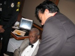 In the back of B.B. King's bus getting and autograph.